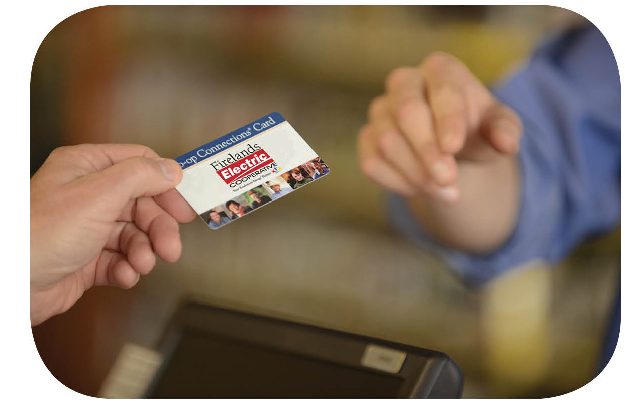person handing card to another